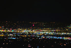 3-watt Luxeon LED seen at a distance of                           14.91 miles (23.85 km) with downtown Salt Lake                           City in the foreground as viewed looking                           toward the northeast